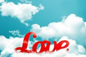 Постер, плакат: The word love red on sky background
