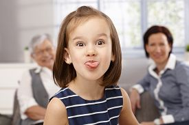 picture of sticking out tongue  - Cute little girl sticking tongue - JPG