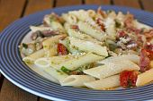 image of pene  - Pasta pene in a blue dish close up
