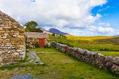 picture of wall cloud  - Connemara rural Irish country house with garden and stone wall green hills and clouds - JPG