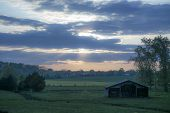 foto of farm land  - beautiful sunset on the spring farm land