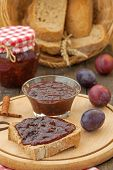 image of fresh slice bread  - Plum jam on slice of bread with fresh ripe plums - JPG
