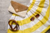 stock photo of clutch  - summer beach accessories strap clutch skirt sunglasses - JPG