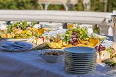 picture of wedding feast  - Festive wedding banquet on a sunny terrace - JPG