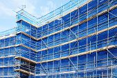 picture of scaffold  - Scaffolding building frame on a building industry construction site - JPG