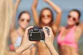 foto of waving hands  - summer vacation - JPG