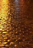 image of paved road  - France a wet paved road in Paris - JPG