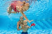 stock photo of mother child  - Young mother teaches to swim 10 month old baby  - JPG