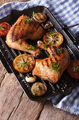 foto of thighs  - Grilled Chicken thighs and vegetables on the grill pan close - JPG