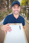 image of bike path  - Happy delivery man with package and clipboard against bike path in amsterdam - JPG