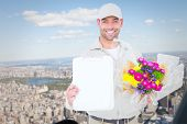foto of clipboard  - Flower delivery man showing clipboard against new york - JPG