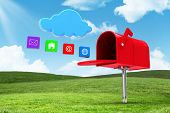 stock photo of postbox  - Red email postbox against field and sky - JPG