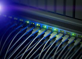 stock photo of flashing  - Network server switch with LED flashing - JPG