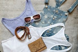 image of denim jeans  - Overhead of essentials of a modern woman - JPG