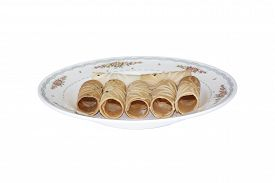 pic of tong  - Tong Muan Rolled Wafer Thailand at the dish on white background - JPG