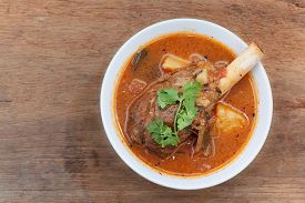 image of lamb shanks  - lamb knuckle stew with vegetables on wooden - JPG