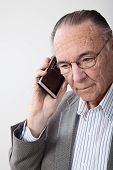 Mature man portrait with cell phone