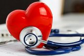 Medical Stethoscope Head And Red Toy Heart poster