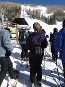 A Lift Line Forms As Skiers Enjoy A Sunny Day