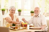 Elderly Couple Having Breakfast