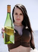 Girl Showing A Bottle