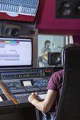 Постер, плакат: Sound Engineer At Recording Studio