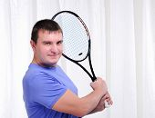 Young man with tennis racket