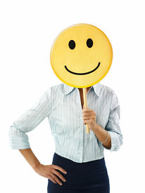 foto of smiley face  - adult business woman holding smiley emoticon on white background - JPG
