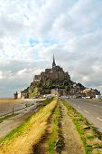 stock photo of mont saint michel  - Road leading to Mont Saint Michel abbey in France