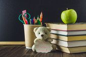 Concept Of Teachers Day. Objects On A Chalkboard Background. Books, Green Apple, Bear With A Sign:  poster