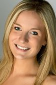 Young Blonde Woman Smiling Headshot