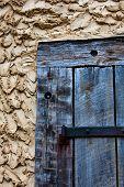Wooden Door in Mud Wall