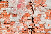 Crack In The Old Wall. Wear Of Brick Masonry. Background. poster