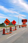 picture of traffic sign  - Road construction signs and cones on a city street - JPG