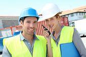 Work team meeting on building site