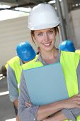 Woman engineer standing on building site