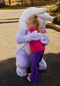 Young girl cuddling Easter bunny