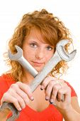 Woman Holding Wrenches Crossed