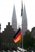 German Flag And Church Towers