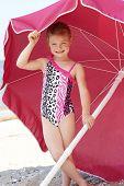 Cute Girl Under Beach Umbrella