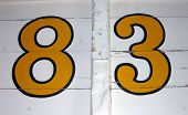 Hand Painted Number 83 On Wooden Background