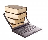 stock photo of online education  - Book stack over laptop  - JPG
