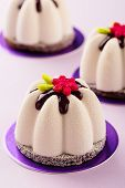 Постер, плакат: Flower Shape Mini Mousse Pastry Dessert Covered With Chocolate Velour And Decorated With Glaze