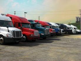 stock photo of truck-stop  - trucks truckstop stop rest trucking 18 wheeler transportation cross country drive driving driver CDL sky big road - JPG