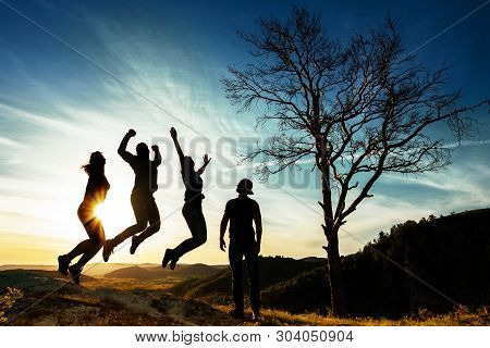poster of Silhouette Of People. People In Jump. Friends Have Fun At Sunset. Funny Friends. Best Friends. Frien