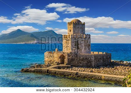 poster of Magnificent three-tiered watchtower built on long cape in the sea. Venetian fort castle Methoni on t