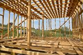 Construction Home Framing Against Blue Sky.wood Frame Residential Building Under Construction.buildi poster