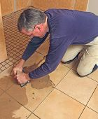 Man grouting ceramic tile