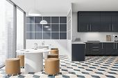 Tiled Floor Kitchen With Two Tables poster