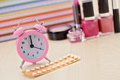 birth control pill with alarm clock - healthcare and medicine